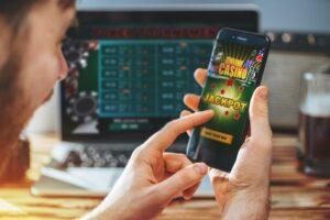 Jak grać na automatach wrzutowych na pieniądze z telefonu w kasynie Goxbet?